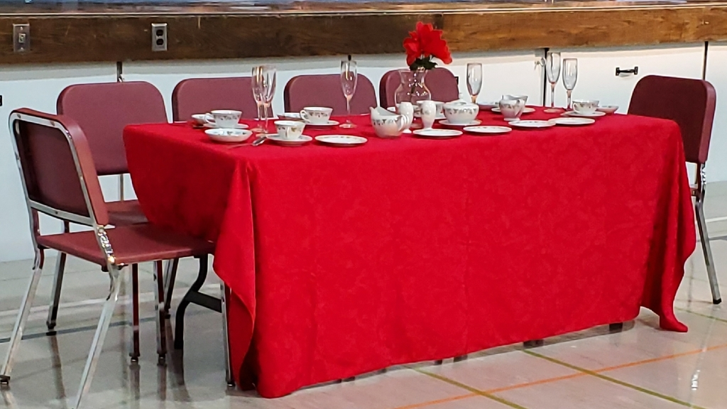 Table set with red cloth.