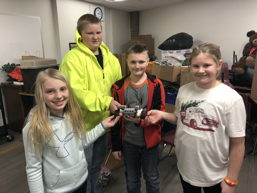 5th grade students showing off their robot.